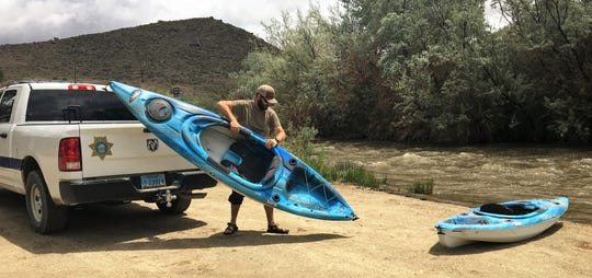 Park Supervisor Randy Denter unloads kayaks at Squeeze Chute.