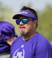 Spanish Springs football coach Eric Borja watches the action during practice on the school practice field on Aug 15, 2018.