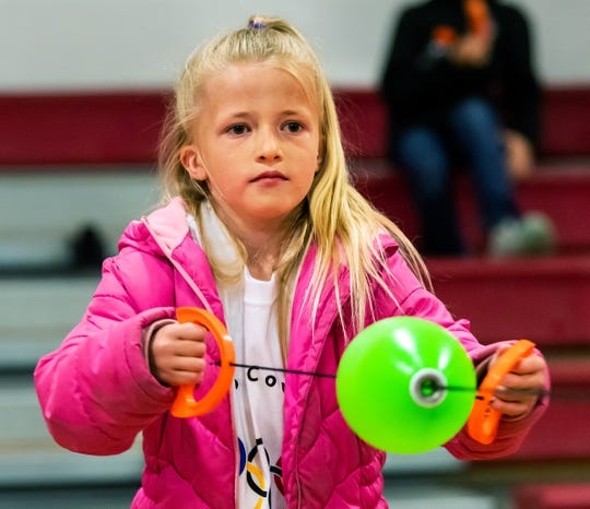 Payton Hrule, 8, from East Valley Elementary School, plays zip ball in the gymnasium.
