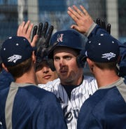 Teammates congratulate Nevada's Weston Hatten after hitting a home run against the Washington State Cougars early in Tursday's home opener at Peccole Park on Feb. 28, 2019.