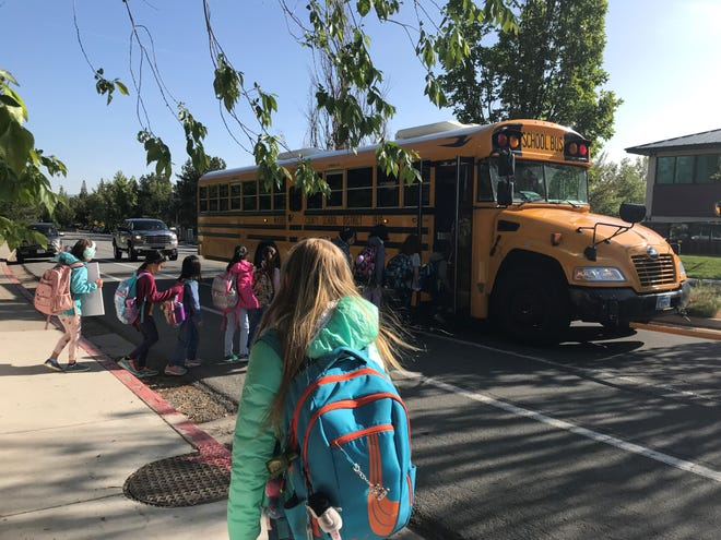 Washoe County School District elementary school students board the bus  outside of the Aspen Ridge Apartments in south Reno. Under a proposal these Caughlin Ranch Elementary School children will be zoned for a different school.
