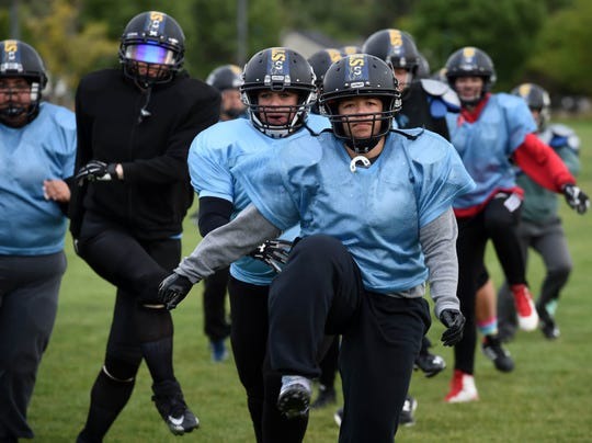 The Nevada Storm women's football team warms during for practice at Mira Loma Park on May 21, 2019. The Nevada Storm is undefeated in their league.