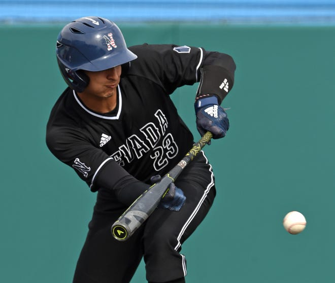 Nevada's Marco Valenzuela bunts and get to first base in Friday game against the Washington State Cougars on March 1, 2019.
