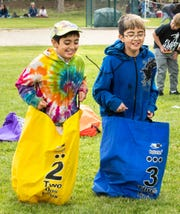 Kaleb Romero, 10, from East Valley Elementary School, left, and his Olympic buddy Nick Romero, 11, from Fernley Intermediate School, participate in a sack race.