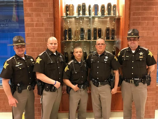 "Recent graduates from the Indiana Law Enforcement Academy Patrolman Robert ""Chuck"" Brown, Patrolman Brent Garrett and Patrolman Alain Lacasse pose with Sheriff Randy Retter and Major Rick Thalls."