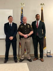 Sheriff Randy Retter poses with two new patrol officers hired by his agency, Dustin Cushing and Jayme Thompson.