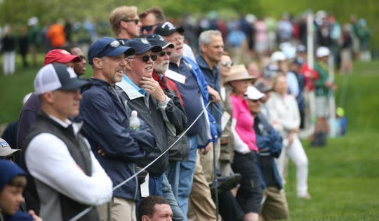 Better weather meant bigger galleries, like on the 15th fairway, during the second round.