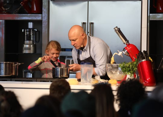 Tom Colicchio brings a pot for Julia Koomen of Pittsford to use to melt butter.