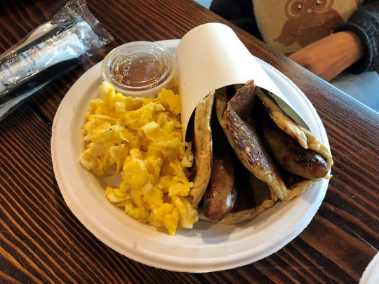 Pigs in a Blanket with a side of scrambled eggs from the Vida Pancake Truck.