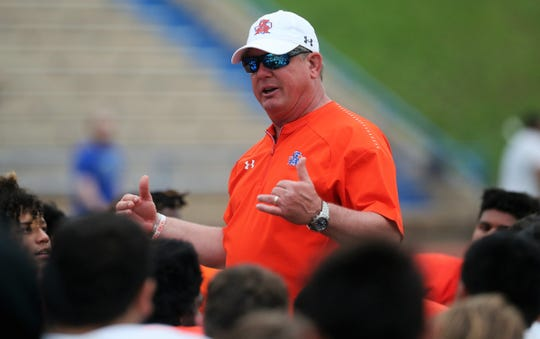 San Angelo Central High School head football coach Brent Davis praises his team after the annual Spring Game at San Angelo Stadium Thursday, May 23, 2019.