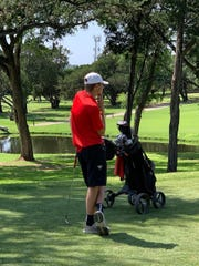 Garden City senior Hagan Halfmann rests on his club and examines his shot at the Class 1A boys state golf tournament in Austin, Texas Tuesday, May 21, 2019.