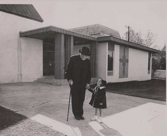 This is Rev. Fr. Daniel Sakellariou and he is holding the hand of Melissa Kouvelis, in front of our church, Nov. 1964.