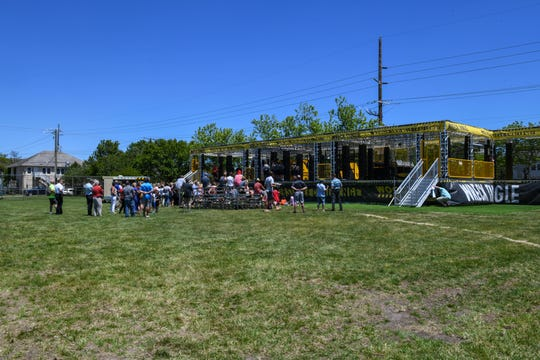 A crowd gathers at the grand opening of the new Woodward WreckTangle obstacle course in Ocean City on Friday, May 24, 2019.