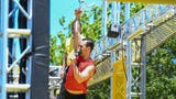 """'American Ninja Warrior' Joe Moravsky, """"the weatherman"""", shows off his skills at the new Ocean City WreckTangle obstacle course on Friday."""