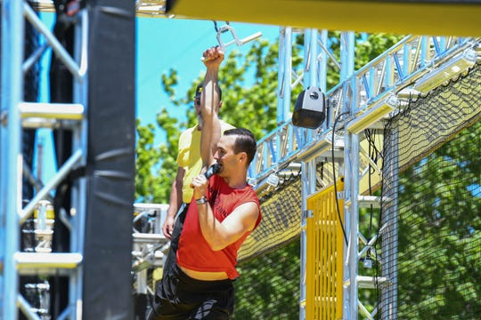 """The Weatherman"" Joe Moravsky, ""American Ninja Warrior"" athlete, coaches attendees about how to complete the new Woodward WreckTangle obstacle course in Ocean City on Friday, May 24, 2019."