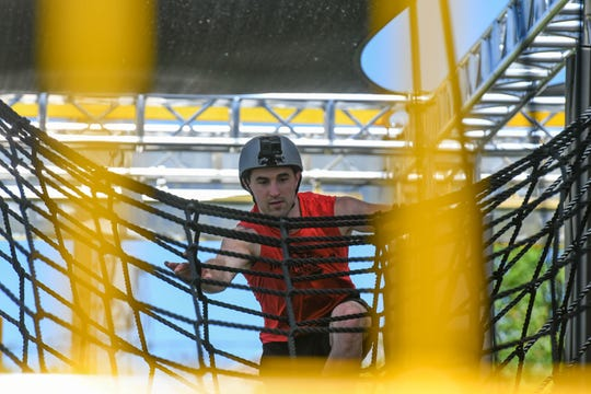 """The Weatherman"" Joe Moravsky, ""American Ninja Warrior"" athlete, tries out the course at the new Woodward WreckTangle obstacle course in Ocean City on Friday, May 24, 2019."