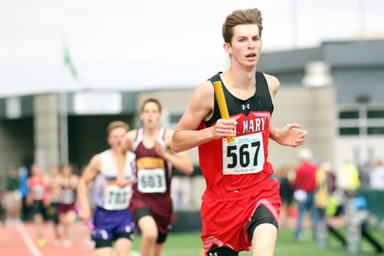 Thomas Eining of Dell Rapids St Mary's runs his leg of the B Boys 4x800 Relay on Friday at Howard Wood in Sioux Falls.