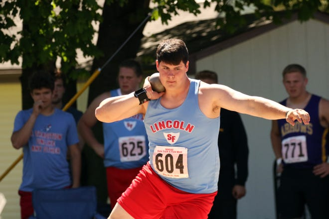 Tyler Hiatt of Lincoln spins before releasing the shot in the Boys AA Shot Put on Friday in Brandon Valley.