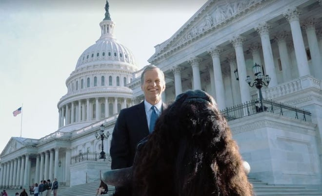 Sen. John Thune, R-SD, wheels a mounted bison head into the U.S. Capitol on Tuesday, bound for the wall of his office.