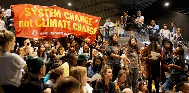 Young people from around the world called for systemic change to address climate change in December 2018 in Katowice, Poland, at the United Nations Climate Change Conference.