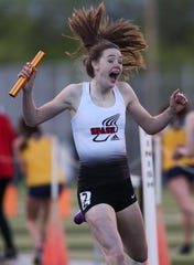 Stevens Point Area High School's Roisin Willis reacts as she crosses the finish line to win the 4x400 relay in a Division 1 sectional track meet on Thursday, May 23, 2019, at D.C. Everest High School in Schofield, Wis.Tork Mason/USA TODAY NETWORK-Wisconsin