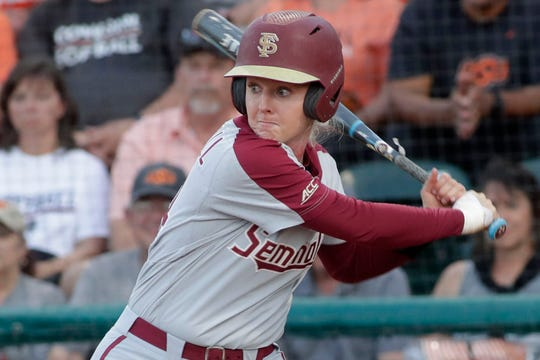 Florida State Seminoles utility player Sydney Sherrill (24) winds up to swing at the pitch. The Florida State Seminoles host the Oklahoma State Cowgirls for the first game of Super Regionals Thursday, May 23, 2019.