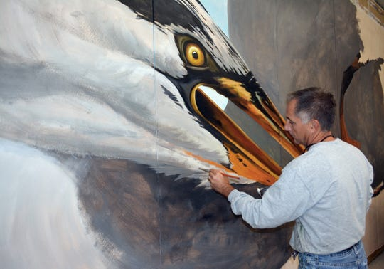 "Artist Michael Rosato painting a mural entitled ""Big Bird"" in his studio in Cambridge, Maryland. Rosato is a 1983 graduate of Florida State University."