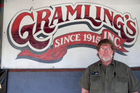 Stan Gramling, owner of Gramling's feed store, poses for a photo outside the store Thursday, May 23, 2019. Gramling's is set to close at the end of June after 104 years of being in business.