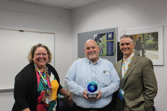 Rob Renzi, CEO, Big Bend Cares, center, honored with inaugural Kris Knab Service Award. Pictured with UPHS Board Members Kelly Otte and Mark Payne.