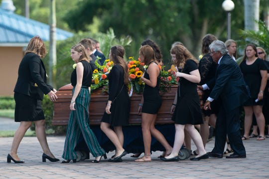 Mourners exit the funeral services for Fort Pierce teenager Layne Chesney while helping move the casket to a waiting hearse on Friday, May 24, 2019, at Westside Church in Fort Pierce. Chesney died May 10, 16 months after over 95% of her body was burned on New Year's Eve 2017. Chesney was a star softball player at Lincoln Park Academy and had earned support from strangers around the world, through area fundraisers and from her favorite recording artist, Billie Eilish.
