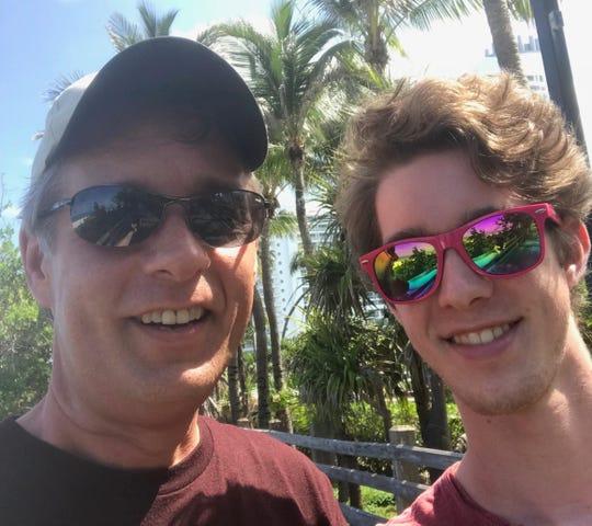 Columnist Gil Smart and his son, Alex, on the boardwalk in Miami Beach last summer.