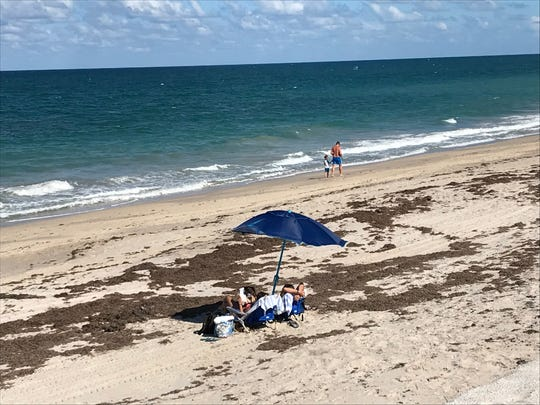 The beach is a popular spot for those enjoying a holiday weekend.