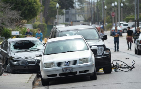 This BMW, left, driven by a drive-by shooter who killed six people and himself, is shown in Isla Vista on May 24, 2014.