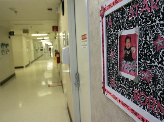 Images of babies born in the obstetrics unit hang on the walls of Santa Paula Hospital.