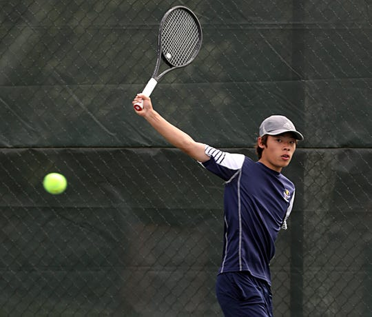 Keio Ryo Sakai returns the ball to White Plains Callum Markowit during Section 1 boys tennis singles semifinals at Edgemont High School in Scarsdale May 24, 2019.