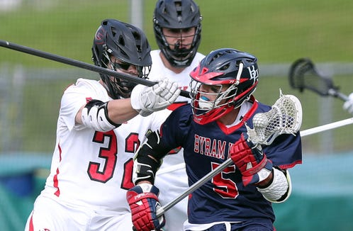 Rye's Brendan LaVelle (32) puts pressure on Byram Hills Ben Mautner (5) during the Section 1 Class C championship game at Lakeland High School in Shrub Oak May 24, 2019.