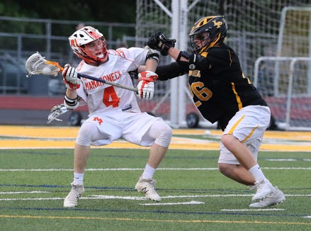 Mamaroneck's Tom Conley is pressured by Lakeland-Panas' Josh Hirschin the Section 1, Class A lacrosse final at Lakeland May 23, 2019. Mamaroneck won 10-4.