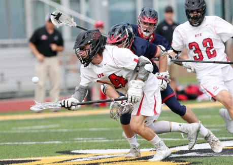 Rye's Johnny Hartnell (44) controls a loose ball against Byram Hills during the Section 1 Class C championship game at Lakeland High School in Shrub Oak May 24, 2019.