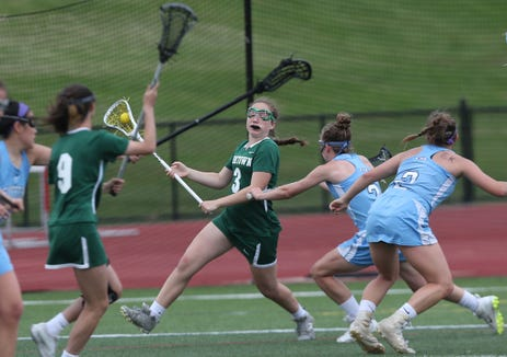 Yorktown's Lindsay Boyle carries ball vs. Suffern during the Section 1 Class B Championship game May 23, 2019. Suffern won 7-6.