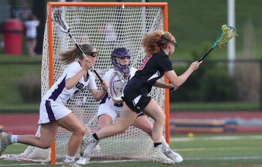 Rye's Catherine Egan (9) tries to get a shot by John Jay goalie Brianna Garofalo (20) during the girls lacrosse Section 1 Class C championship game at Fox Lane High School in Bedford May 23, 2019. John Jay won the game 8-7.