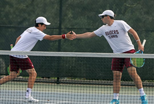 Scarsdale's Nikolay Sahakyan and teammate Jason Shuler celebrate a shot during game action against Harrison's Connor Griff and David Griff during Section 1 boys tennis boys doubles semifinals at Edgemont High School in Scarsdale May 24, 2019.