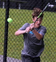 Bronxville's Liam Krall returns the ball to Hendrick Hudson's Josh Nelson during Section 1 boys tennis singles semifinals at Edgemont High School in Scarsdale May 24, 2019.