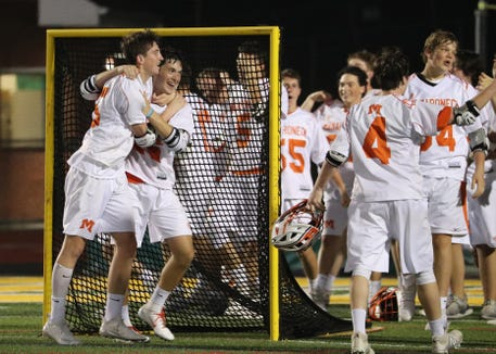 Mamaroneck players celebrate their 10-4 win over Lakeland-Panas in the Section 1, Class A lacrosse final at Lakeland May 23, 2019.