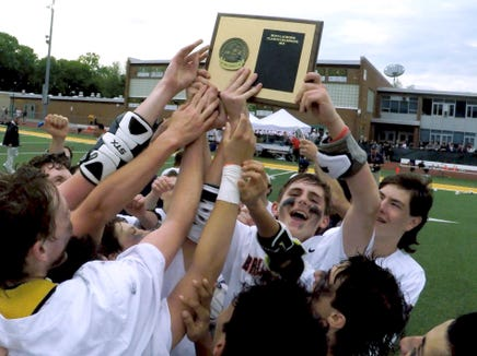 Briarcliff players celebrate their 9-8 overtime win over Pleasantville in the Class D lacrosse final at Lakeland May 23, 2019.