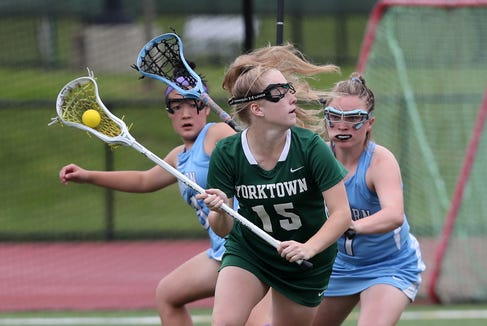 Yorktown's Kelsey McDonnell (15) tries to escape the pressure from Suffern's Grace Krebs (1) during the Section 1 girls lacrosse championship game at Fox Lane High School in Bedford May 23, 2019.