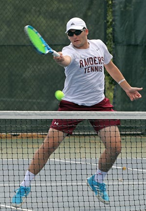 Scarsdale's Nikolay Sahakyan (right) and Jason Shuler, pictured here during the Section 1 doubles semifinals at Edgemont High School on May 24, won the state title on Saturday.