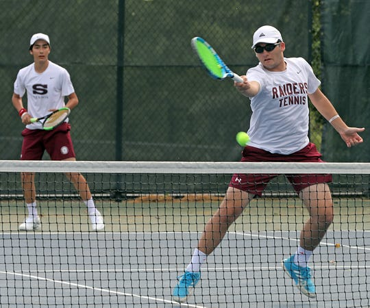 Scarsdale's Nikolay Sahayken returns the ball with his teammate Jason Shuler during game action against Harrison's Connor Griff and David Griff during Section 1 boys tennis boys doubles semifinals at Edgemont High School in Scarsdale May 24, 2019.