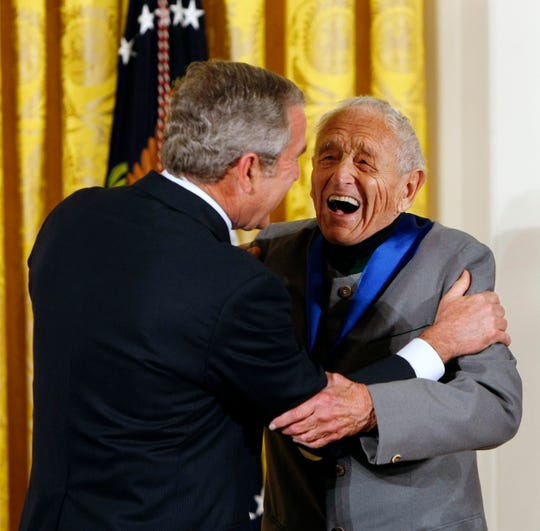 Painter Andrew Wyeth, of Chadds Ford, Pennsylvania, right, laughs with President Bush as he receives the 2007 National Medal of Arts, Thursday, Nov. 15, 2007, during a ceremony in the East Room of the White House in Washington.
