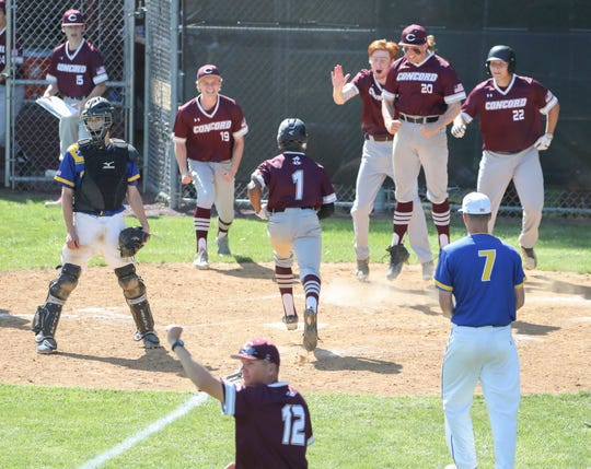 Concord's Myles Eaddy (1) scores the game winner from first base on Steven Cornog's double in Concord's 6-5 walk-off win in the first round of the DIAA Baseball Tournament at Concord High School.