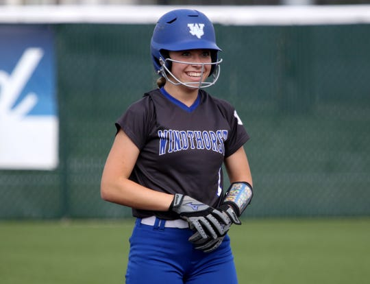 Windthorst's Kora Pennartz smiles to her dugout after hitting a double against Archer City Thursday, May 23, 2019, at Midwestern State University's Mustangs Park.